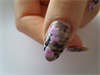 Newspaper mani whith flowers